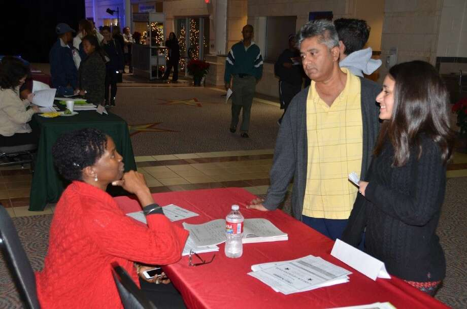 Cypress Lakes High School counselor Shelly James-Perelion assists a parent and student at the CFISD Career Options Fair in December. James-Perelion is one of 93 high school counselors in the school district. Photo: Submitted Photo