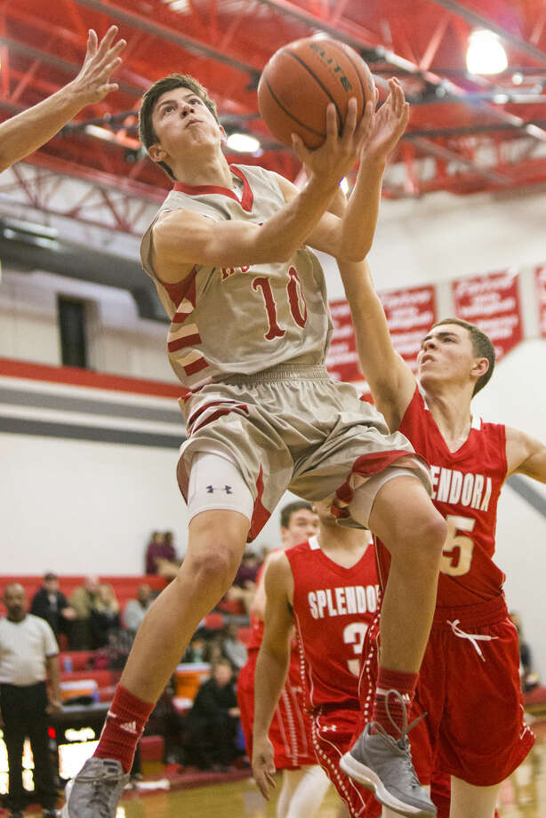 Huffman's Dillon Todd (10) leaps through the defense for a layup during Huffman's 75-45 victory over Splendora on Feb. 3, 2015, at Hargrave High School. Photo: ANDREW BUCKLEY