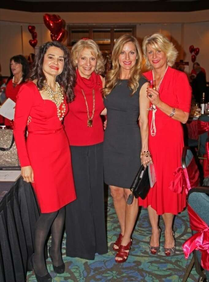 More than 300 bay area fashionistas donned their favorite red outfits and gathered for the Go Red For Women Luncheon to help raise funds for the American Heart Association Friday (Feb. 28). Photo: KRISTI NIX