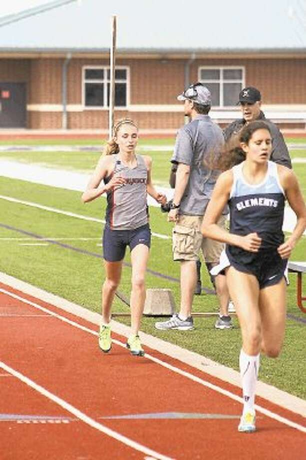 Dawson track athlete Abbie Harrelson set a school record in the 1,600 meters with her time of 5:22 that took top honors at the Angleton Invitational. Harrelson also placed third in the 3,200 in 12:17. Photo: SUBMITTED PHOTO / @WireImgId=2666537