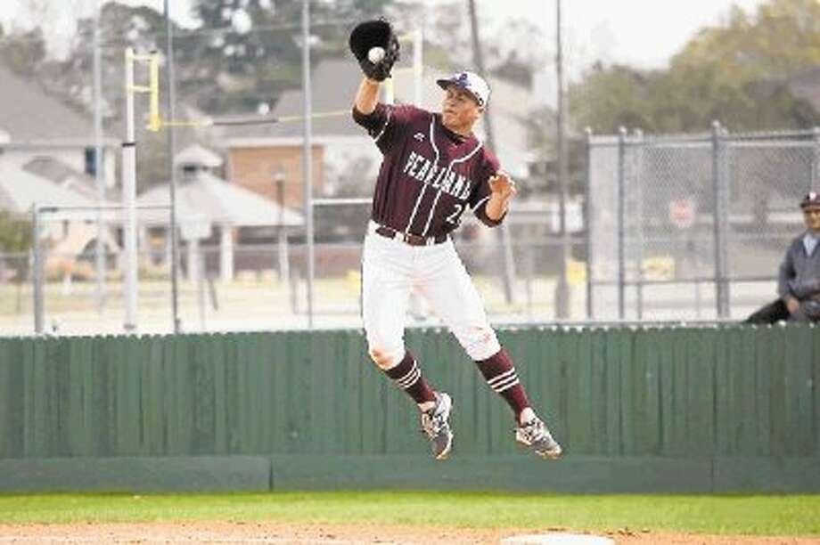Pearland first baseman Jake Crain (21) goes high to catch a wild throw in a tournament game Friday against Friendswood. Photo: KIRK SIDES / © 2014 Kirk Sides / Houston Community Newspapers