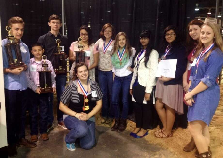 Porter High School students won several awards at the Houston Livestock Show and Rodeo. From left:Rigden Wienken, Christopher Leiva, Geoffrey Giannone, Brenda Reyes, Ashley Smart, Sophie Wyatt, Tasnuva Haier, Daniella Mata, Miriam Donis, Stormy Bell, and in front Jennifer Not pictured Brianna guerra and Tanner Hodgkinson. Photo: Submitted Photo