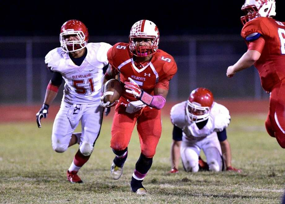 Jay Bradford (5) of the Splendora Wildcats runs away from a pursuing Jonathan Rodriguez (51) of the Cleveland Indians. Photo: Submitted