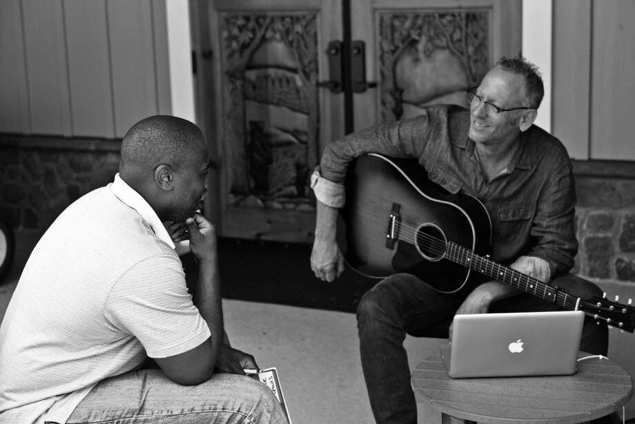Darden Smith works with a veteran to write a song.