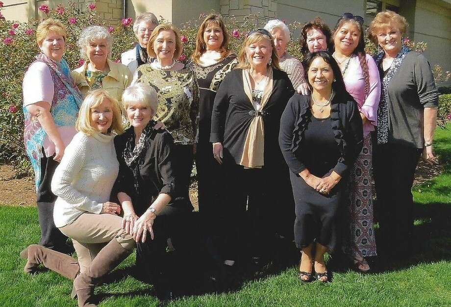 """Recently enjoying the Lunch at the Club activity at """"Golf Club of Houston"""" are Hi Neighbor members, back row, from left — Debbie Campbell, President ; Marian Marrone, Penny Gaido, Judy Miles, Norma Jean Gonzales, Nancy Foisner, Linda Herndon, Margie Nicolai, Juanita Eddins, Cheryl Daciek, and Kay Caffey. Front row, from left — Francesca Fowler and Janet McDonald."""