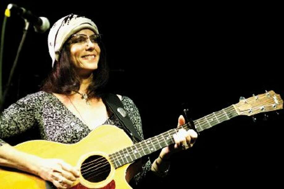 Former Observer reporter Maria Moss performs as part of the duo Hogan & Moss. Following treatment for breast cancer, Moss set aside her journalism career and became a touring musician.