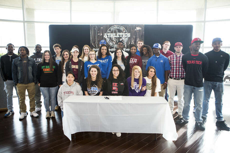 The 28 student atheltes from Humble ISD who signed letters of intent pose for photos during a National Signing Day ceremony Feb. 4, 2015, at the Humble Civic Center. Photo: ANDREW BUCKLEY