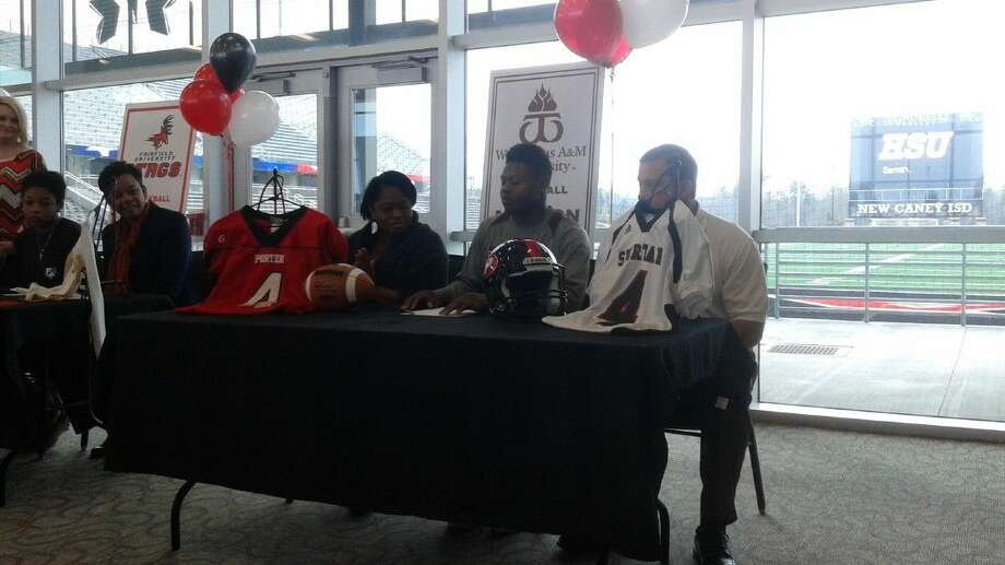 Marlon Lewis signs with West Texas A&M University. Photo: Nate Brown