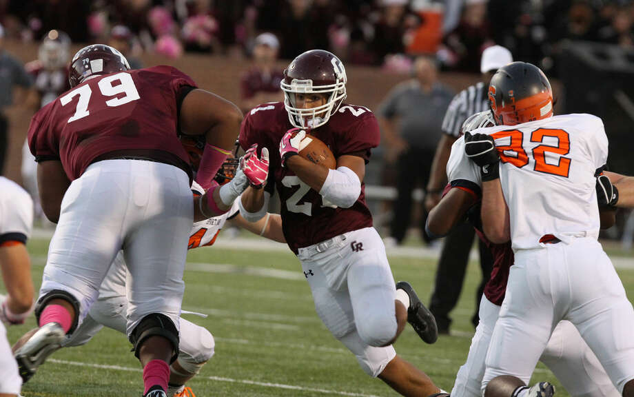 Cinco Ranch's Jonathan Lugo runs against Seven Lakes as Isaiah Edwards blocks Oct. 23 at Rhodes Stadium in Katy. To view or purchase this photo and others like it, go to HCNPics.com. Photo: Staff Photo By Alan Warren
