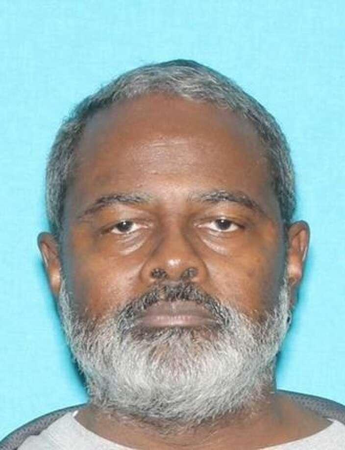 0602fa1c6c1 Clemons is a black male who wears glasses and has a gray beard. He is