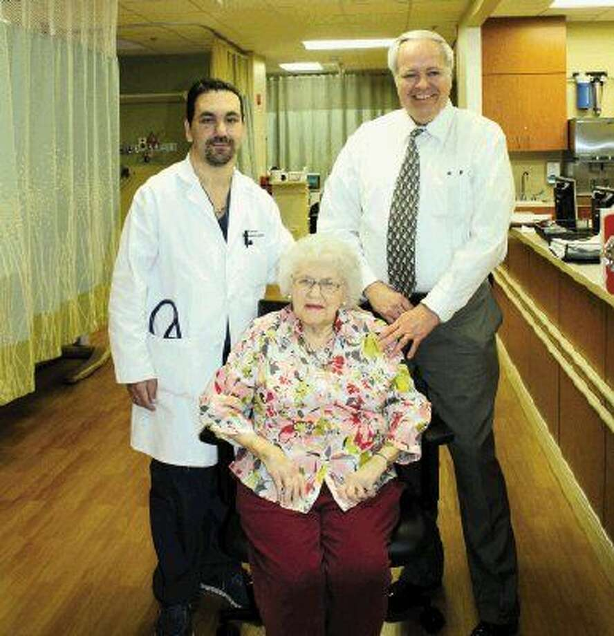 Dr. Rick Ganim reunites with heart patient Marie Holt pictured with Steve Tillotson, her son-in-law, two weeks after her interventional heart procedure was performed that saved her life.