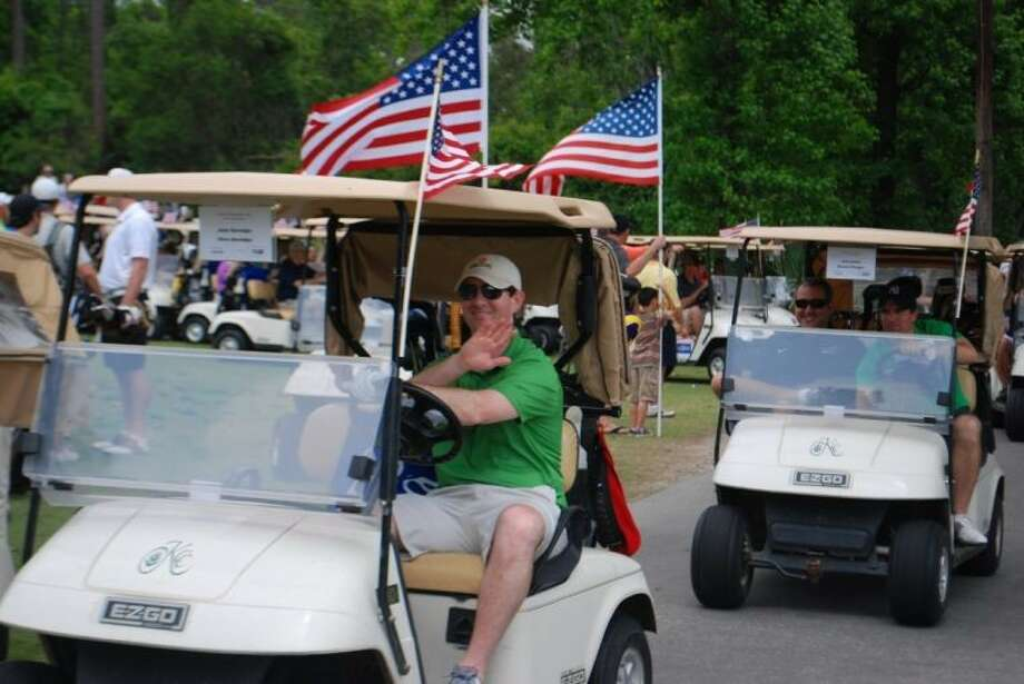 Golfers head out on the course at last year's Kingwood Fallen Heroes Memorial Golf Tournament.