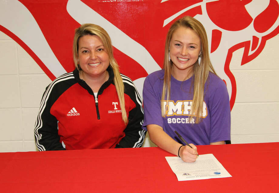 Madison Link (on the right) signs a National Letter of Intent to play soccer at the University of Mary Hardin-Baylor.