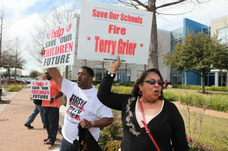 Kathy Blueford-Daniels and Mike Smith in front of HISD headquarters prior to the school board's March 13 vote to re-purpose Jones High School and close Dodson Elementary. Photo: Photo By Alan Warren
