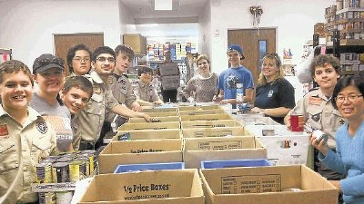 Scouts from Pack 584 of the Texas Skies District help organize donations to Scouting for Food at Katy Christian Ministries.