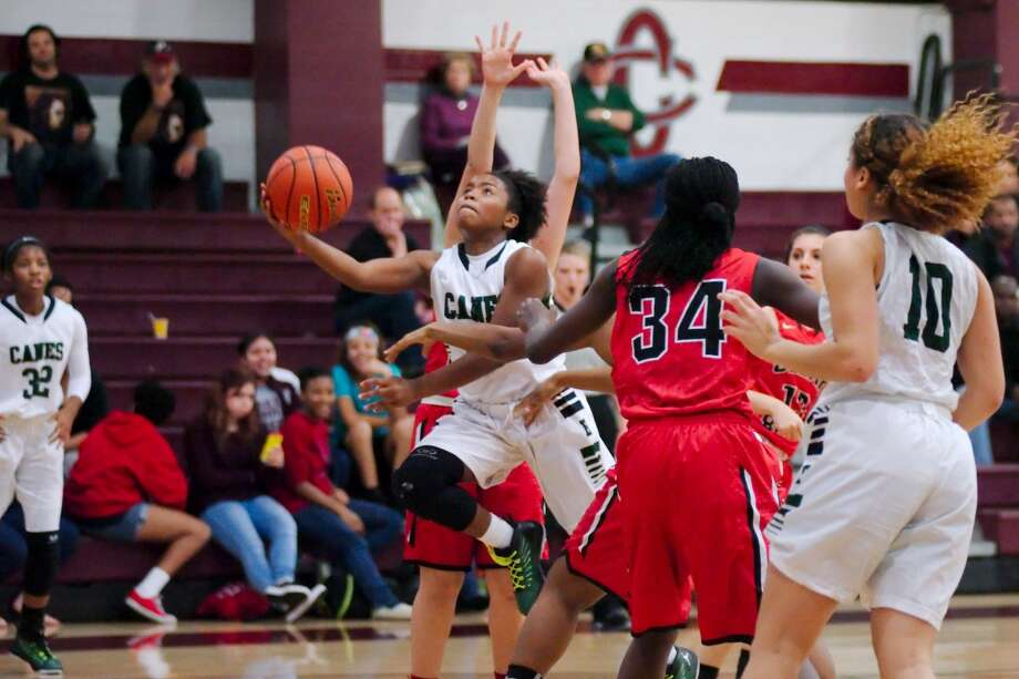 Hightower's Maddison Glass (25) drives to the basket against Clear Brook in the Peggy Whitley Classic basketball tournament Dec. 4. The Lady Hurricanes defeated Alief Taylor 74-37 on Feb. 3 to clinch the District 23-6A championship. Photo: Kirk Sides