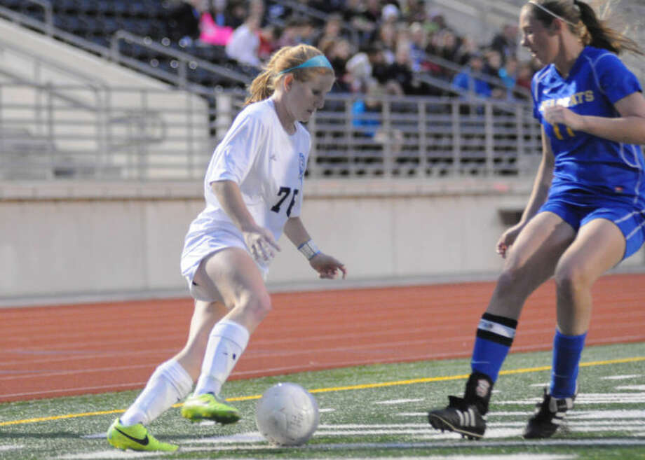Kingwood's Breezy Moore makes a move on a defender against Klein on Friday at Turner Stadium. Photo: Keith MacPherson