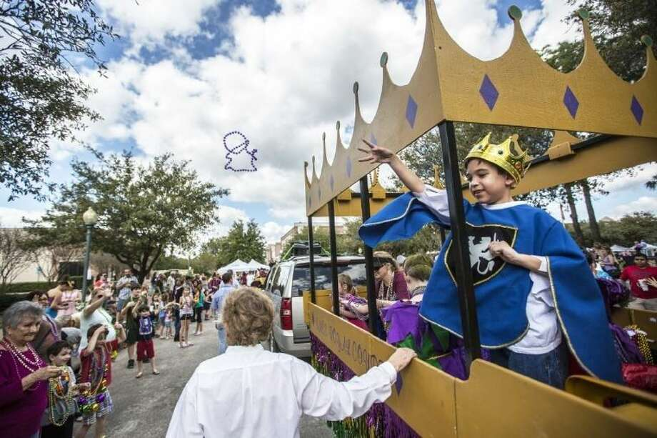 Parade participants throw beads to guests at a past Mardi Gras Festival and Parade.