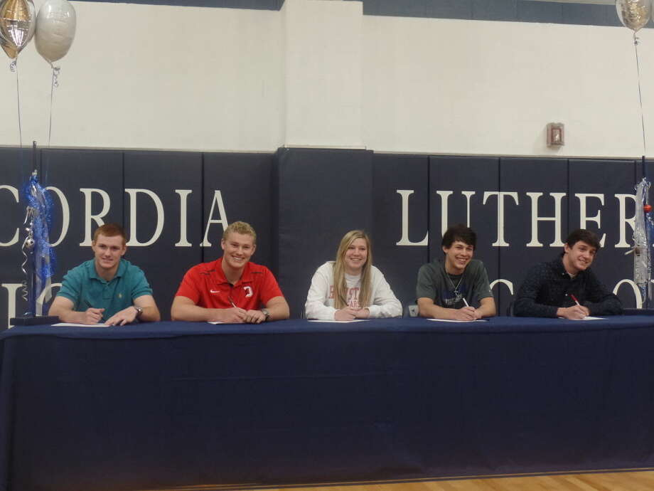 Five Concordia Lutheran students sign National Letters of Intent to play college sports on National Signing Day. Photo: Staff Photo By Cameron Brock