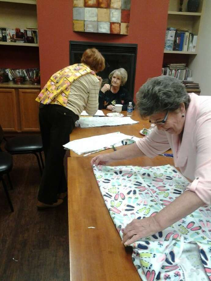 Kingwood Senior Village residents sew super hero capes for sick children at Kingwood Medical Center.