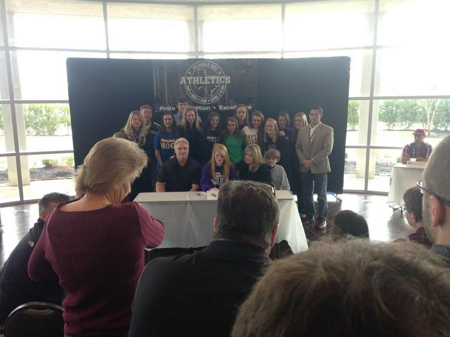 Surrounded by family and friends Kingwood High senior Breezy Moore signs soccer scholarship to play at Stephen F. Austin on Wednesday, Feb. 4, 2015, at the Humble Civic Center.