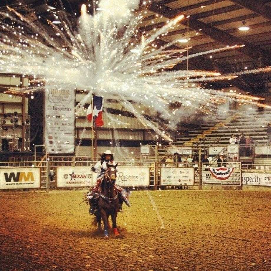 The All American Cowgirl Chicks kick off the Humble Rodeo every year with a patriotic celebration.
