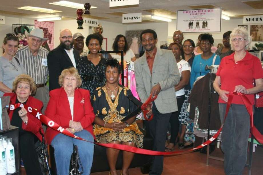 Several members of the Greater Cleveland Chamber of Commerce were present during the ribbon cutting ceremony at Back on the Rack resale shop, which was opened by Cheryl and Raphael Driver, to help fund a local women's shelter. Photo: STEPHANIE BUCKNER