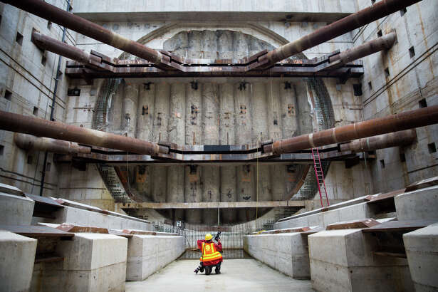 Associated Press photographer Ted Warren photographs Bertha's exit wall in the extraction pit, Monday, Oct. 3, 2016.