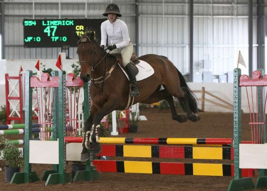 """Kim Segal jumps """"Limerack"""" during Education Day last year at the Pin Oak Charity Horse Show. Photo: Alan Warren"""