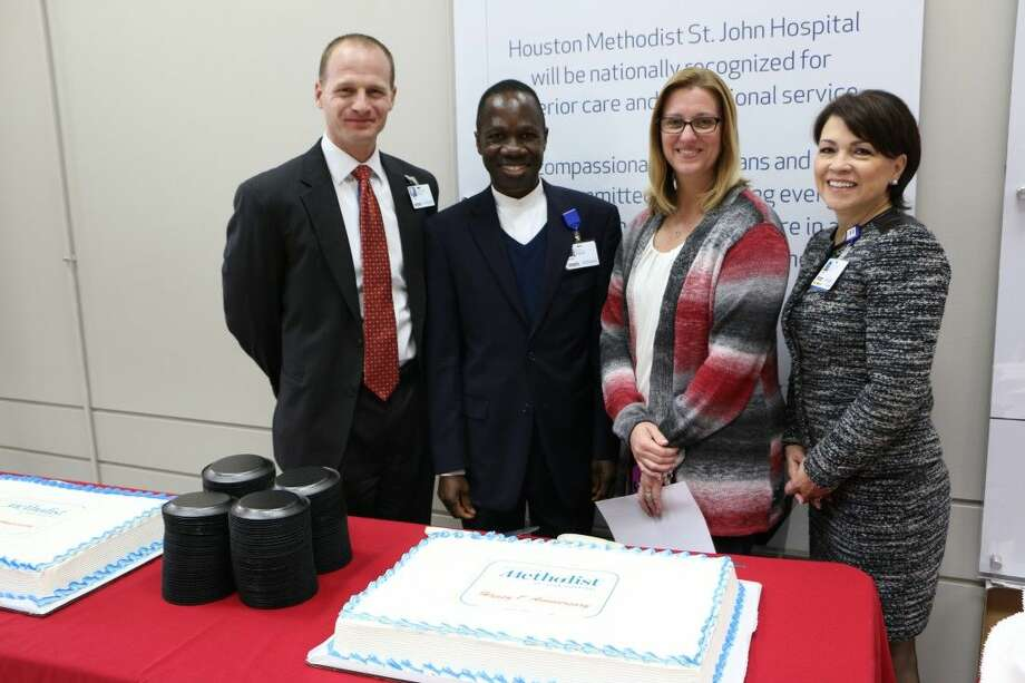 (L-R) Dan Newman, Chief Executive Officer; Father Rueben Nwankwor, Director of Spiritual Care and Values Integration; Sherry Tumbleson, Vice President and Chief Nursing Officer; and Susan Garcia, Vice President, Operations attend a prayer service and celebration on Feb. 2 for St. John employees and guests as they observe their one-year anniversary as a Houston Methodist hospital.