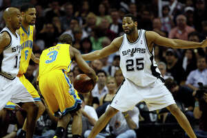 Spurs' Robert Horry crowds New Orleans Hornets Chris Paul during the first half of Game 6 of the NBA Western Conference semifinals at the AT&T Center on May 15, 2008.