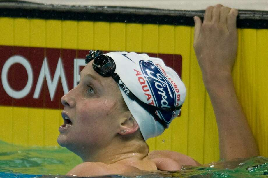 Annie Chandler looks at her time during the 100-meter breaststroke finals of the 2008 H.S. Olympic Swimming Trials in Omaha, Neb., on July 1. Photo: Express-News File Photo / 2008 Daniel Johnson Daniel Johnson, All Rights Reserved