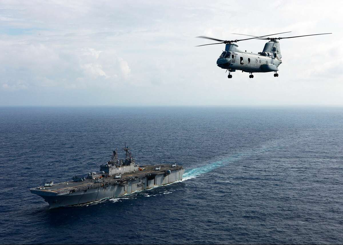 CARIBBEAN SEA - NOVEMBER 6: In this handout from the U.S. Navy, a Sea Knight helicopter assigned to Marine Medium Helicopter Squadron departs the multi-purpose amphibious assault ship USS Iwo Jima on November 6, 2010 in the Caribbean Sea. The purpose of the mission is to conduct aerial damage assessments of Haiti after Hurricane Tomas made landfall. Iwo Jima is preparing to support the Government of Haiti, the UN Stabilization Mission in Haiti and the U.S. Agency for International Relief. (Photo by U.S. Marine Corps Sgt. Samuel R. Beyers/U.S. Navy via Getty Images)