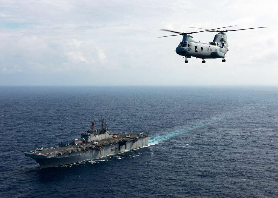 CARIBBEAN SEA - NOVEMBER 6: In this handout from the U.S. Navy, a Sea Knight helicopter assigned to Marine Medium Helicopter Squadron departs the multi-purpose amphibious assault ship USS Iwo Jima on November 6, 2010 in the Caribbean Sea. The purpose of the mission is to conduct aerial damage assessments of Haiti after Hurricane Tomas made landfall. Iwo Jima is preparing to support the Government of Haiti, the UN Stabilization Mission in Haiti and the U.S. Agency for International Relief. (Photo by U.S. Marine Corps Sgt. Samuel R. Beyers/U.S. Navy via Getty Images) Photo: U.S. Navy/Getty Images