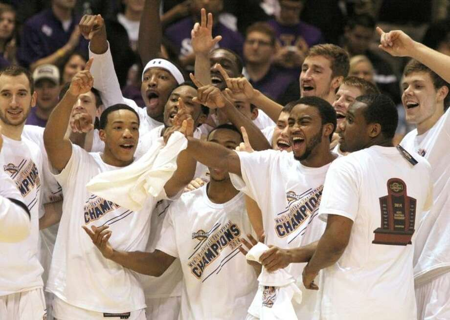 Stephen F. Austin players celebrate winning the 2014 Southland Conference Tournament over Sam Houston, March 15 at the Merrell Center in Katy. The Lumberjacks improved to 31-2. To view this photo and others like it, go to HCNPics.com. Photo: Alan Warren