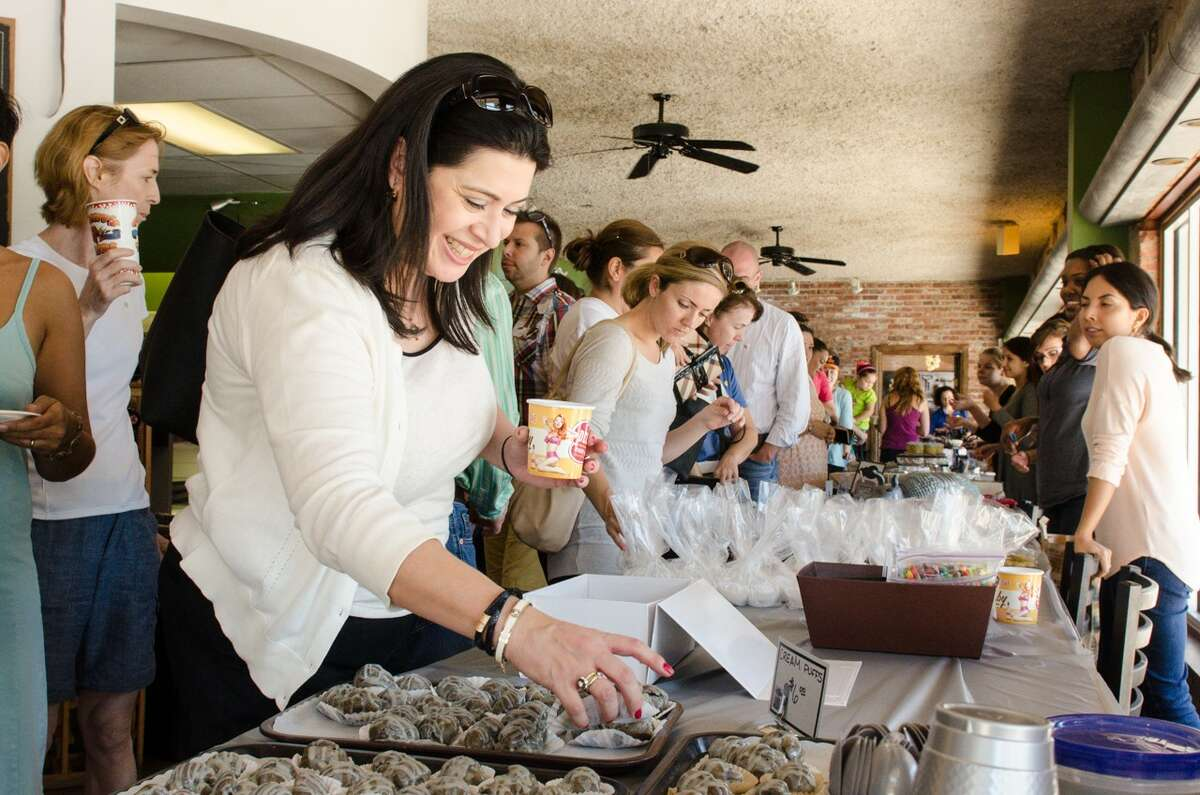 The third annual Depressed Cake Shop will be held on Oct. 9 at Paulie's, 1834 Westheimer. The event, which features gray baked goods (to signify depression), is a fundraiser to help raise awareness of mental illness. Shown: scenes from 2015 Depressed Cake Shop event.