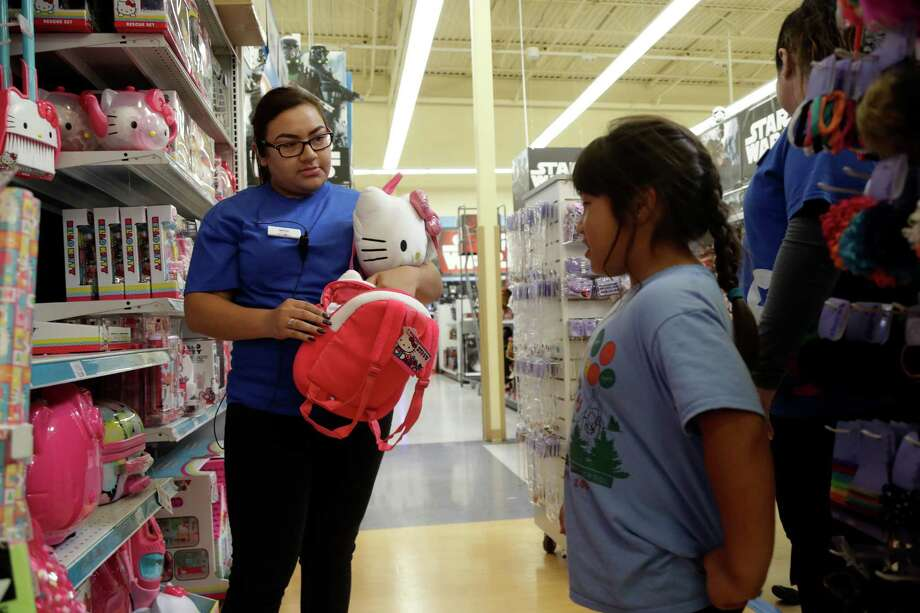 In this Friday, Sept. 30, 2016, photo, Mitzi Solorio, a former seasonal employee now working full time, helps out a customer at a Toys R Us store in San Jose, Calif. Retailers are dangling lots of incentives to lure temporary holiday workers in a tight labor market. That includes increased pay, additional discounts and more flexibility in schedules. Photo: Marcio Jose Sanchez /Associated Press / Copyright 2016 The Associated Press. All rights reserved.