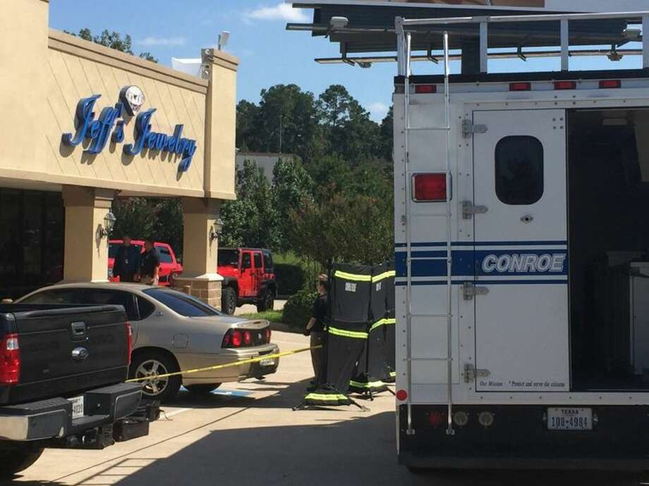 One assailant was shot and killed during an attempted robbery at Jeff's Jewelry store along Texas 105 West in Conroe around noon Monday. Photo: Catherine Dominguez, Conroe Courier