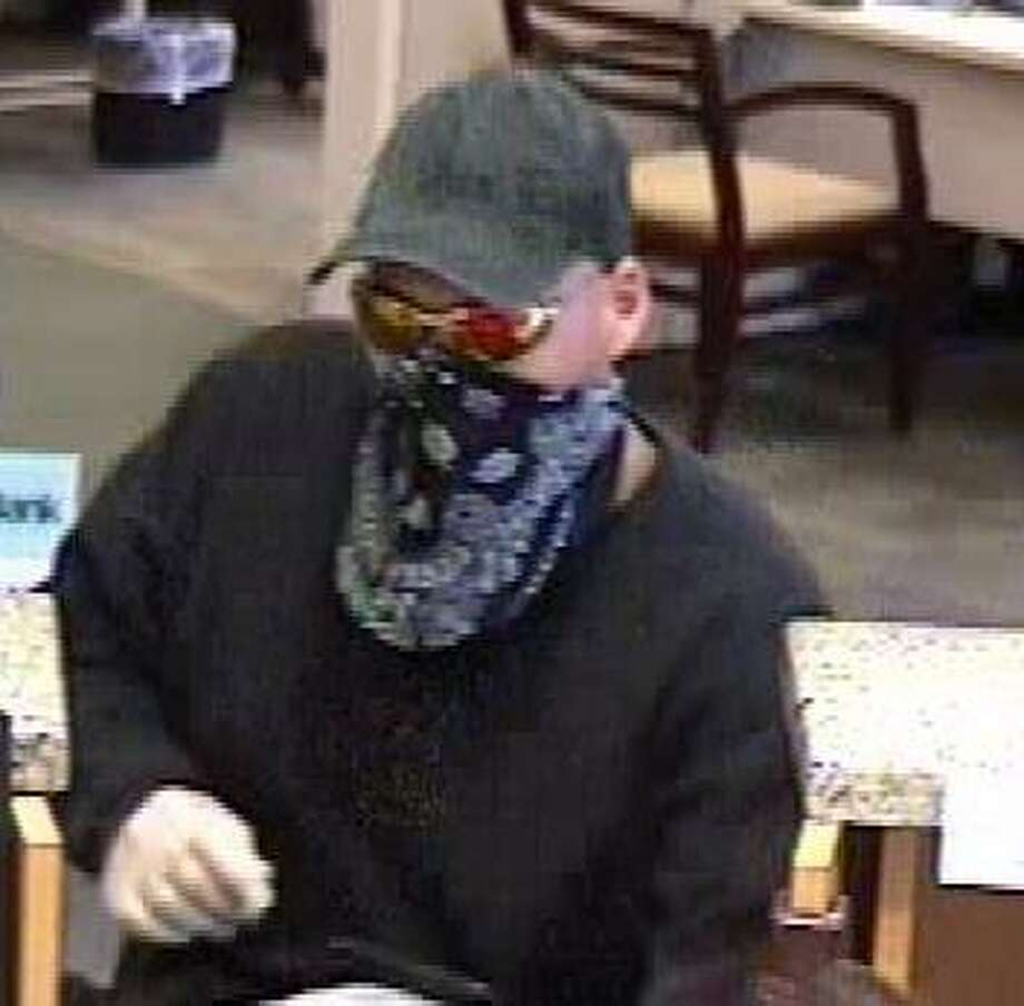 Surveillance footage of the who robbed an Amergy Bank in Missouri City today, thenmaked his intrepid escape on a kid-sized BMX bicycle. Photo: Courtesy FBI Houston Press Office