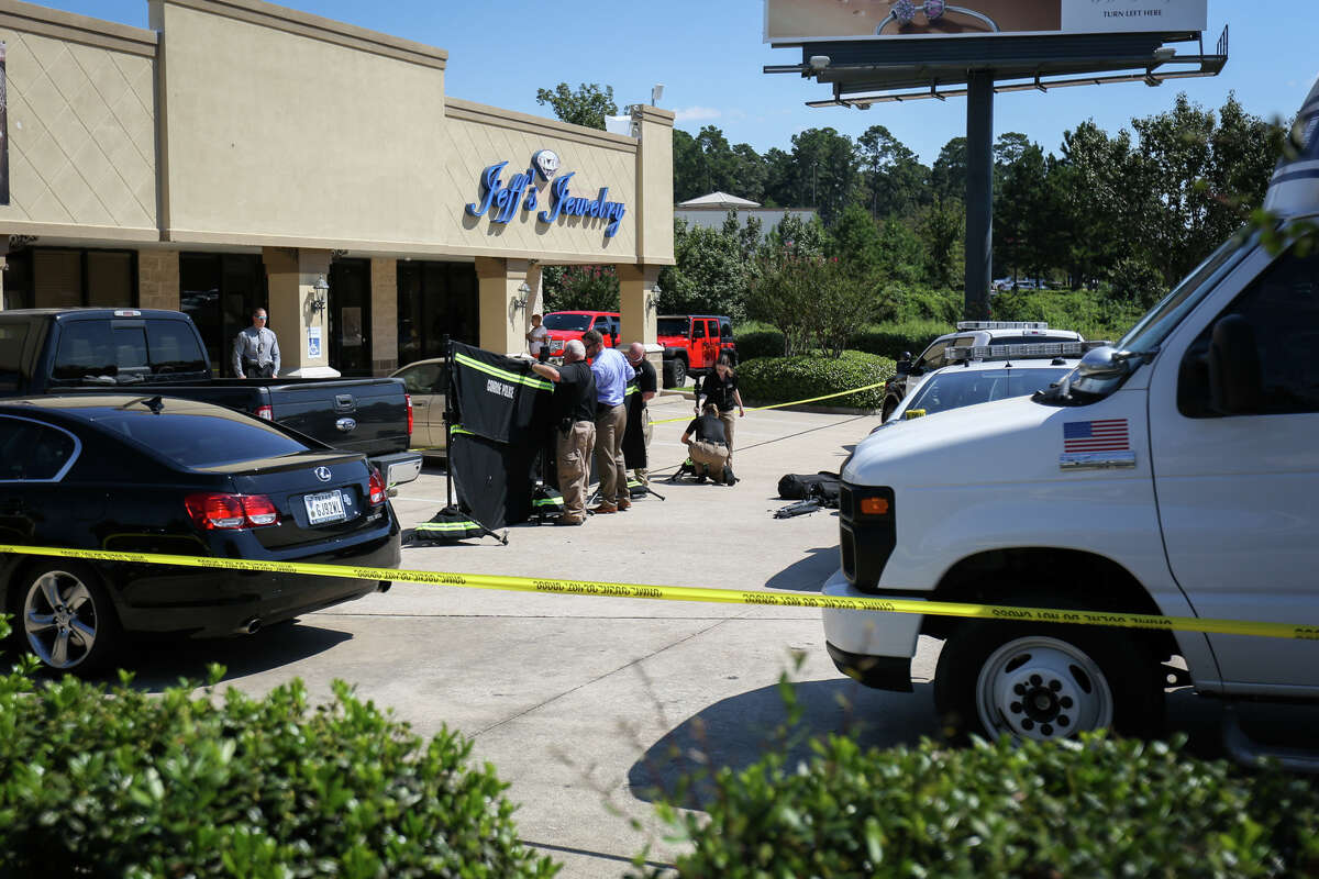 Conroe police investigate a jewelry store robbery that resulted in the shooting of one suspect by store employees on Monday, Oct. 3, 2016, Jeff's Jewelry off of West Davis Street in Conroe. Three suspects were still at large.