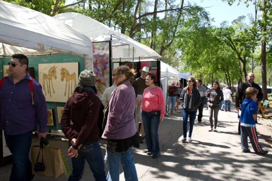 Visiting the artists at a recent Bayou City Art Festival in Memorial Park. Photo: Trish Badger