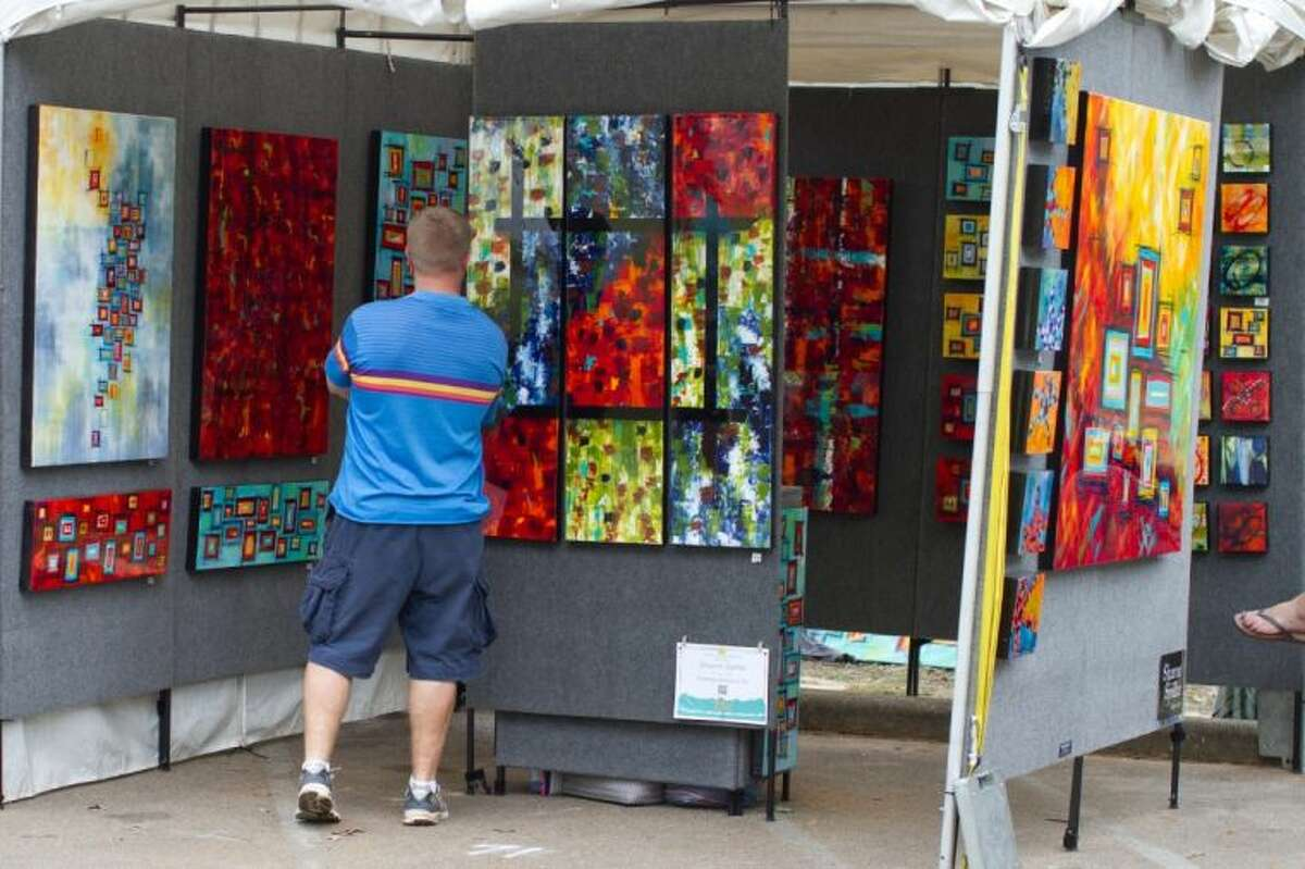 A patron studies art at a recent Bayou City Art Festival at Memorial Park.