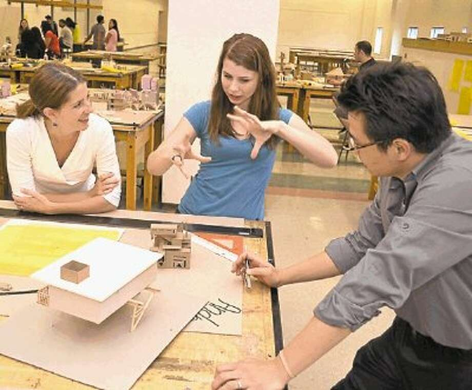 Anne Eamon (left), co-director of the Wonderworks architecture program with former High School for Performing and Visual Arts student Jillian Mitchell, and UH architecture instructor John Tsai. Photo: Submitted / @WireImgId=2666459