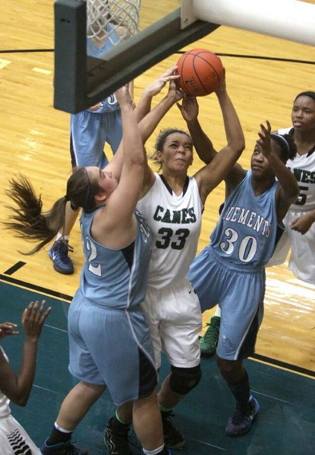 Chelsea Lott (33) and Hightower defeated Clear Lake 67-43 in the Region III-6A bi-district playoffs Feb. 16. Photo: Alan Warren