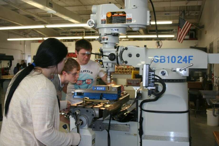 Alexis Cherry, Eric Brocken and Tristan Groh all work together during their construction class at Splendora High School, where they learn about the trade using several different machines. Photo: STEPHANIE BUCKNER