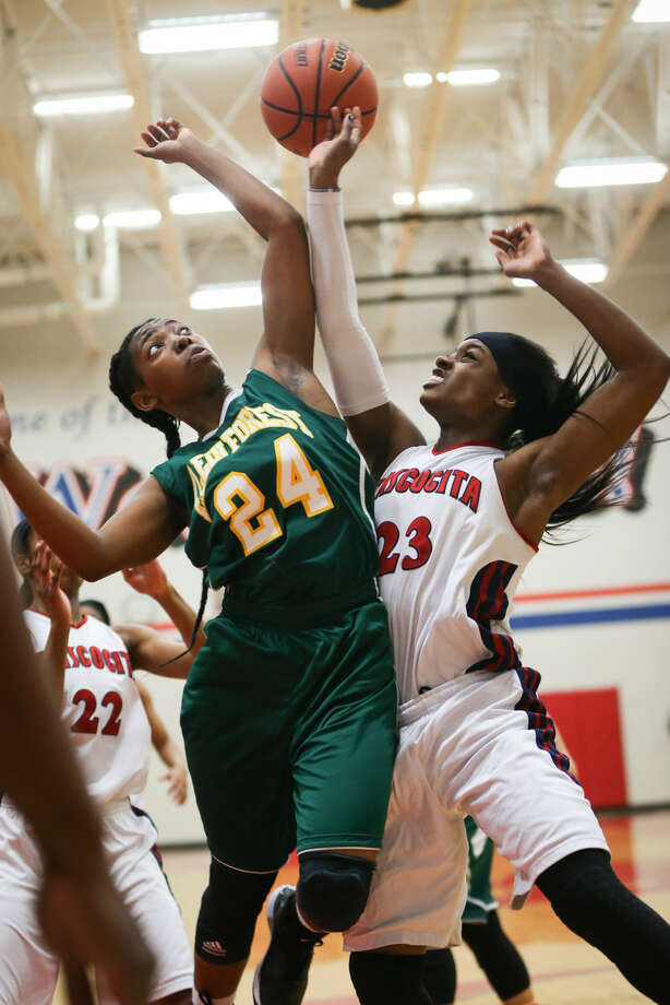 Atascocita's Erica Stewart (23) collides with Klein Forest's Jachelle Hudson (24) as they attempt a rebound during the high school girls basketball game on Monday, Feb. 16, 2015, at Oak Ridge High School. To view more photos from the game, go to HCNPics.com. Photo: Michael Minasi