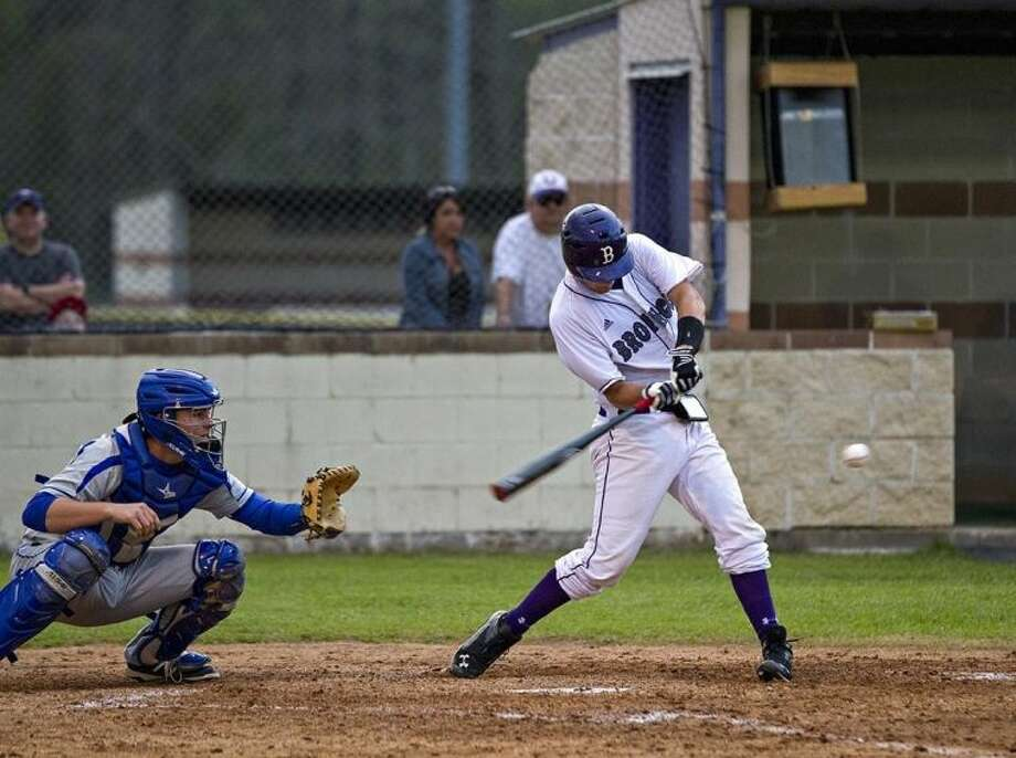 Kevin Roe (11) hit this pitch for a grand slam against C. E. King on Friday, March 21. Photo: AMANDA JORDAN