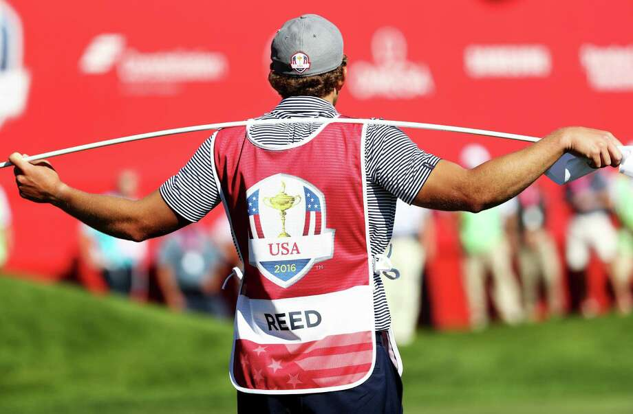 UTSA grad Kessler Karain, San Antonio-born golfer Patrick Reed's brother-in-law and caddie, was on the bag for the United States' Ryder Cup triumph. Photo: Sam Greenwood / Getty Images / 2016 Getty Images