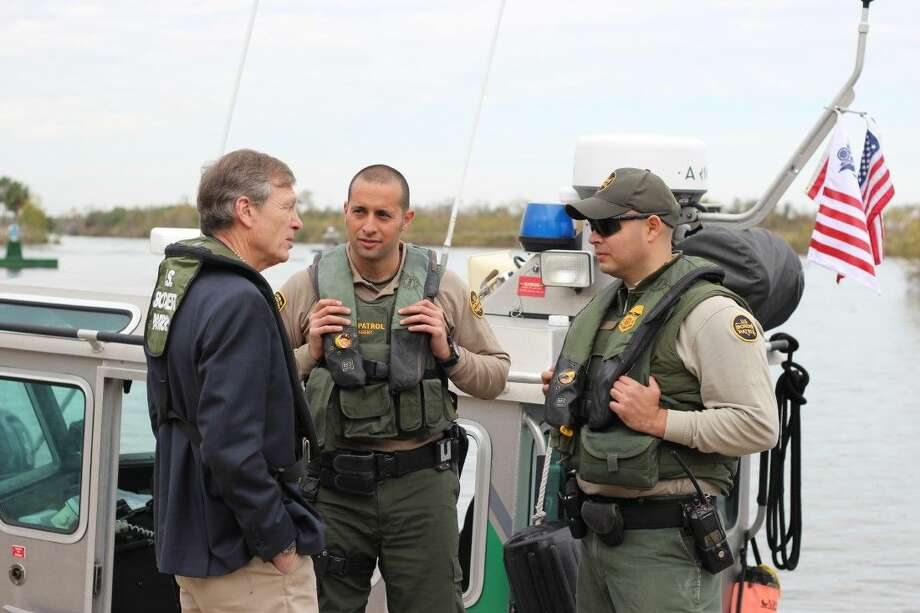 Rep. Babin (R-Texas) discusses border security with border patrol agents on the Rio Grande.
