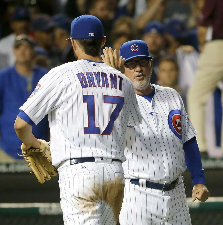 The Cubs' Kris Bryant and manager Joe Maddon face either the Giants or Mets. Photo: Charles Rex Arbogast, Associated Press